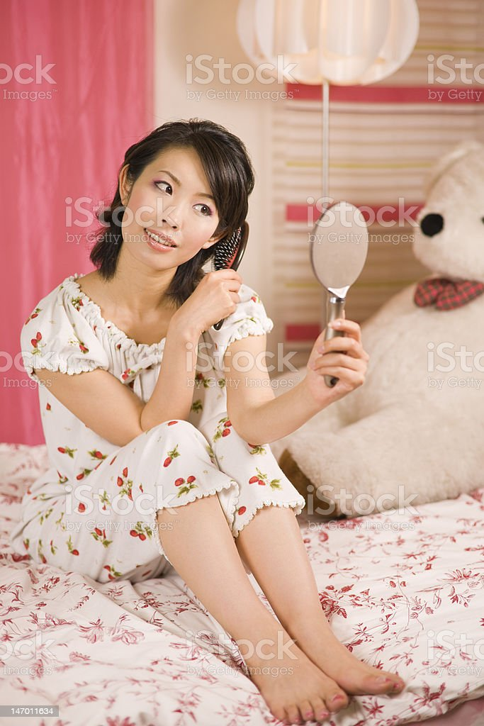 Japanese woman brushing hair royalty-free stock photo