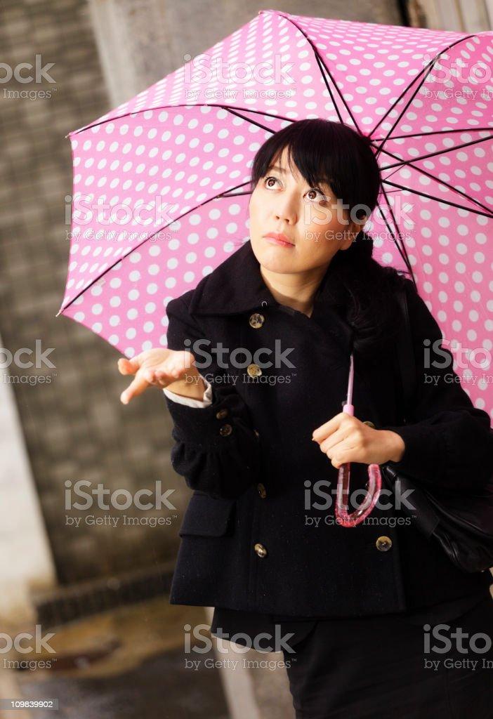 Japanese Woman Checking for Rain stock photo