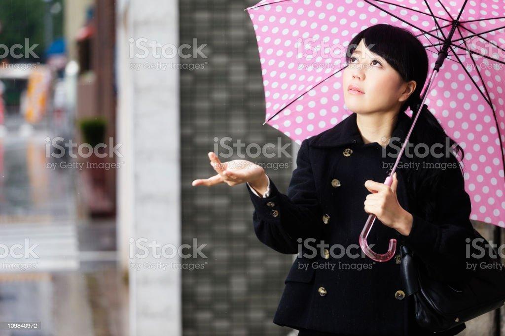 Japanese Woman Checking for Rain royalty-free stock photo