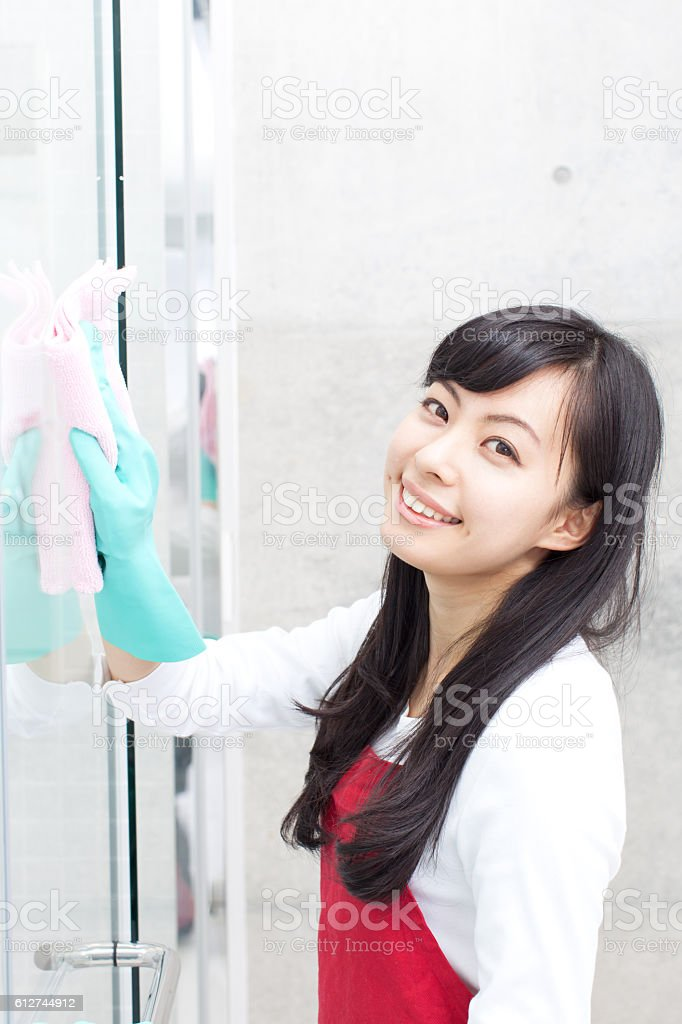 Japanese woman cleaning a bathroom stock photo