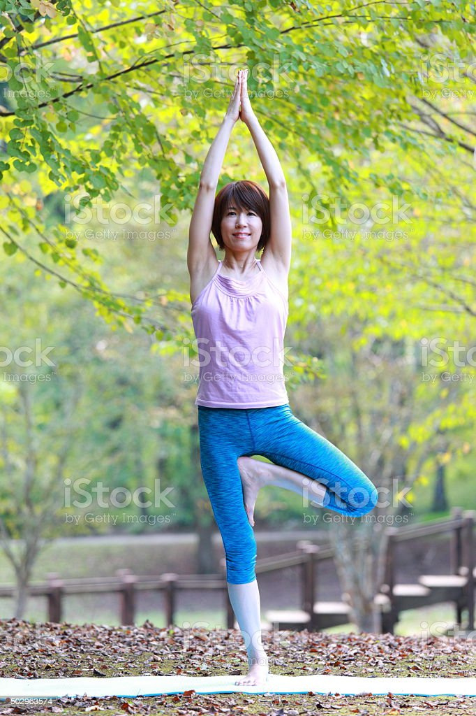 Japanese Woman Doing YOGA 'tree pose' stock photo