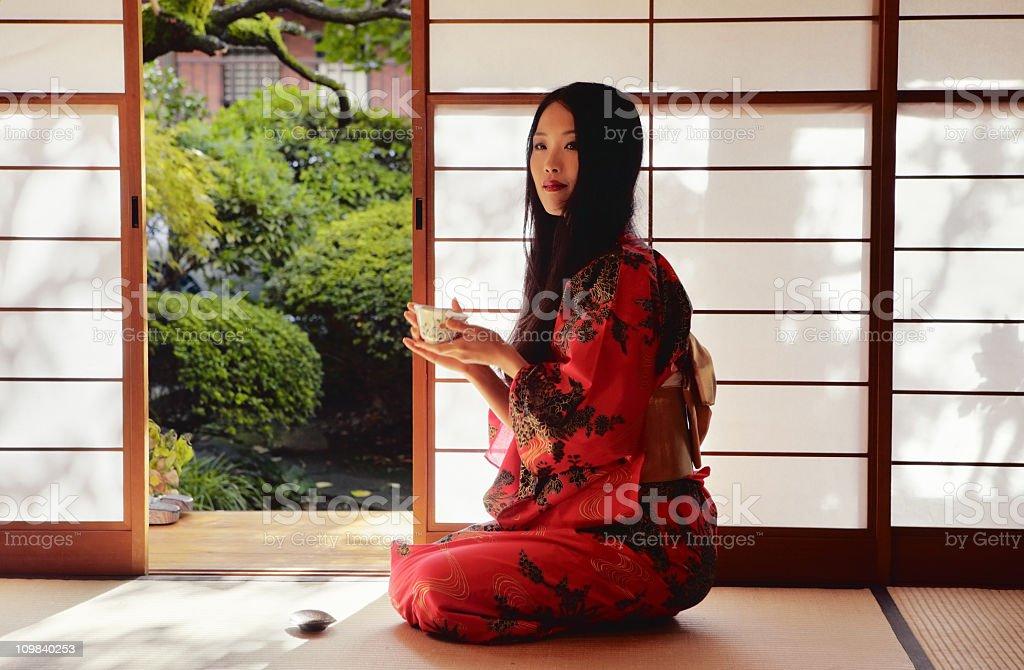 Japanese Woman Drinking Tea royalty-free stock photo