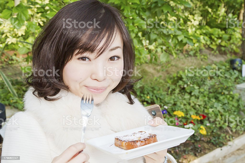 Japanese Woman Eating French Toast royalty-free stock photo