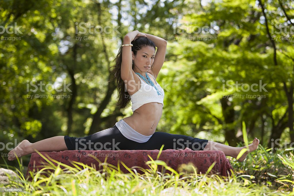 Japanese woman gives a sexy yoga look towards the camera royalty-free stock photo