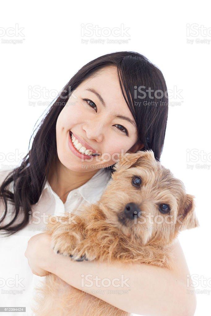 Japanese woman holding a dog stock photo