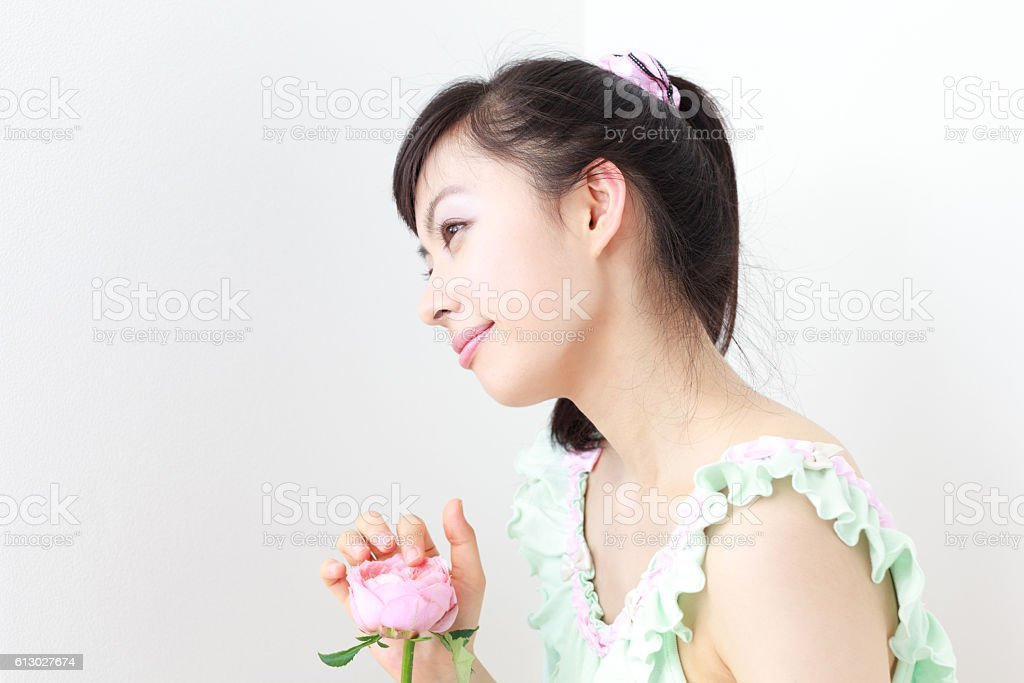 Japanese woman holding a flower stock photo