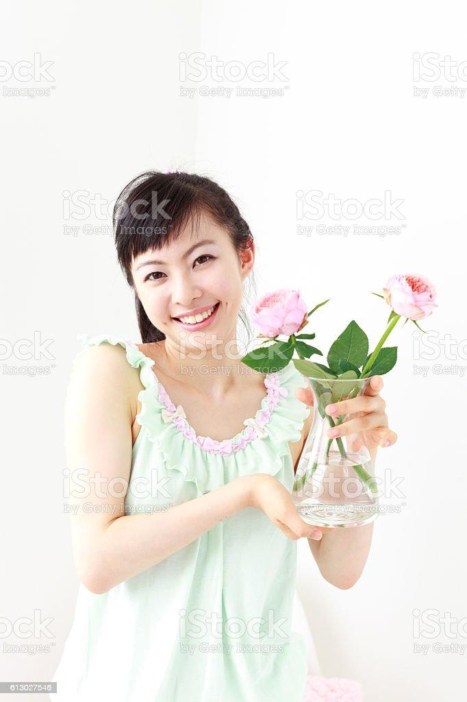 Japanese woman holding a flower vase stock photo