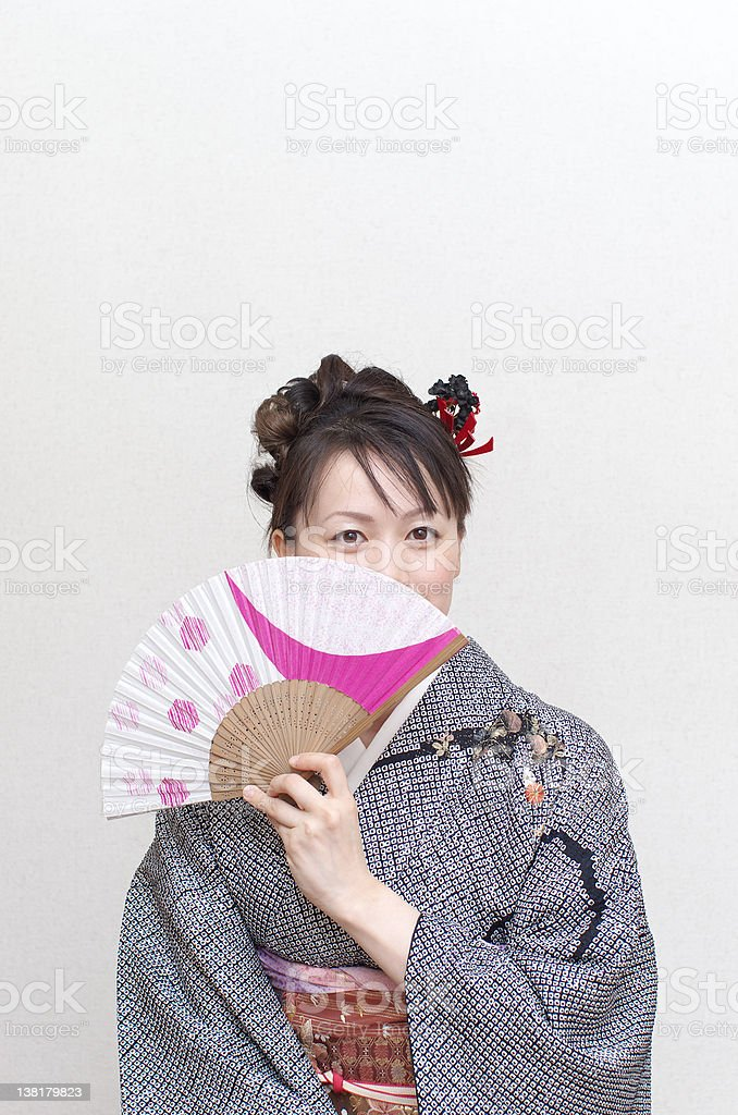 Japanese woman holding a hand fan stock photo