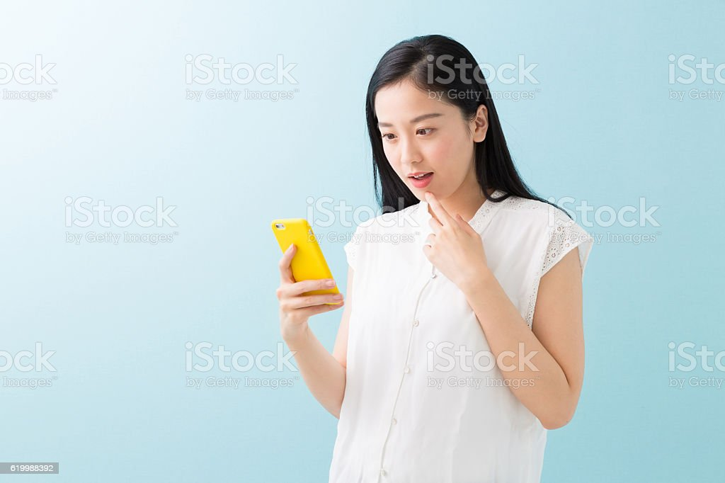 Japanese woman holding a smart phone stock photo