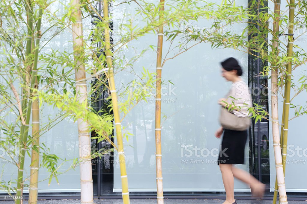 Japanese woman in a suit runs stock photo