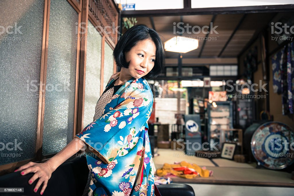 Japanese Woman in Blue Floral Fattern Kimono Posing, Kyoto, Japan stock photo
