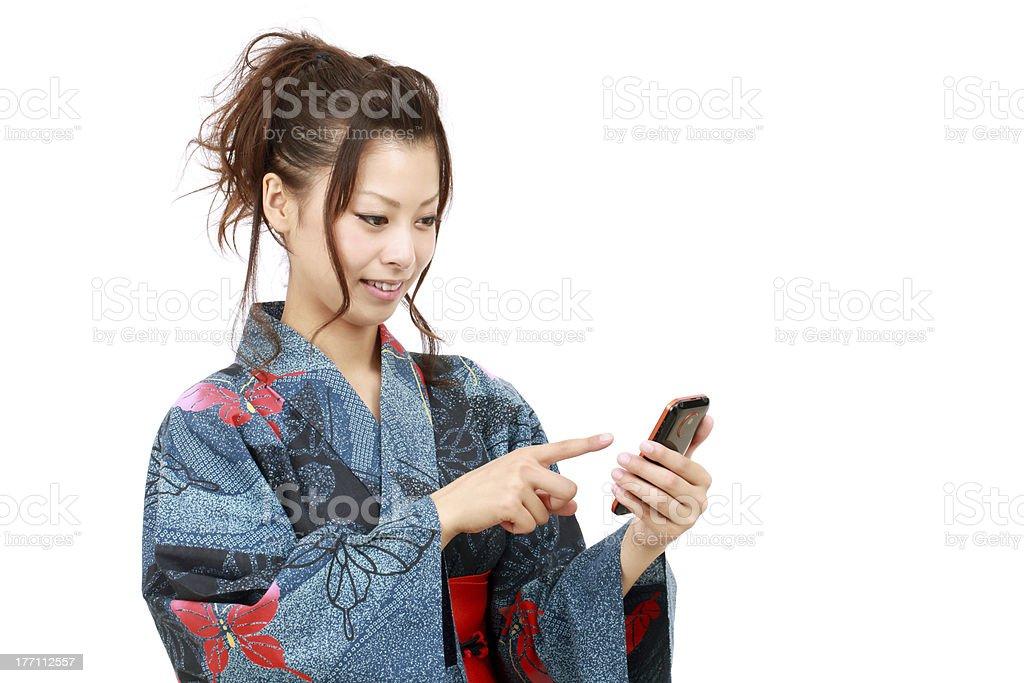 Japanese woman in clothes of kimono stock photo