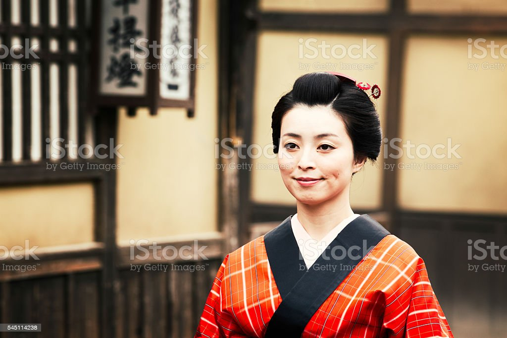 Japanese woman in edo costume walking and smiling in village stock photo