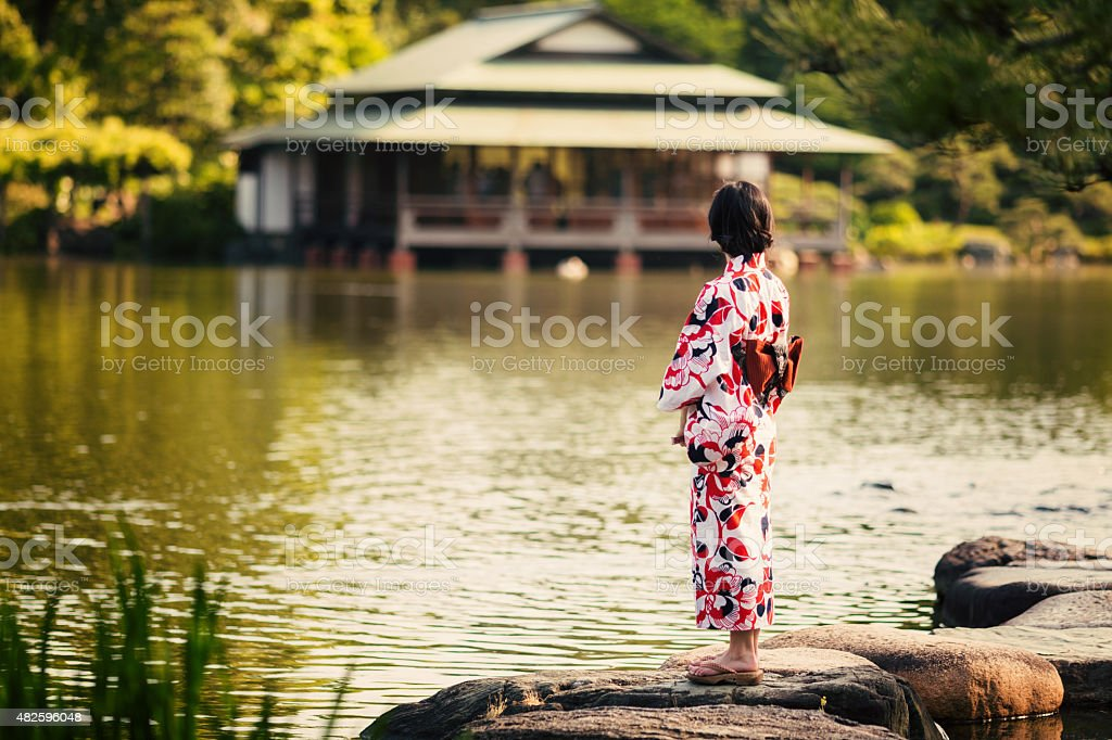 Japanese woman in front of beautiful house stock photo