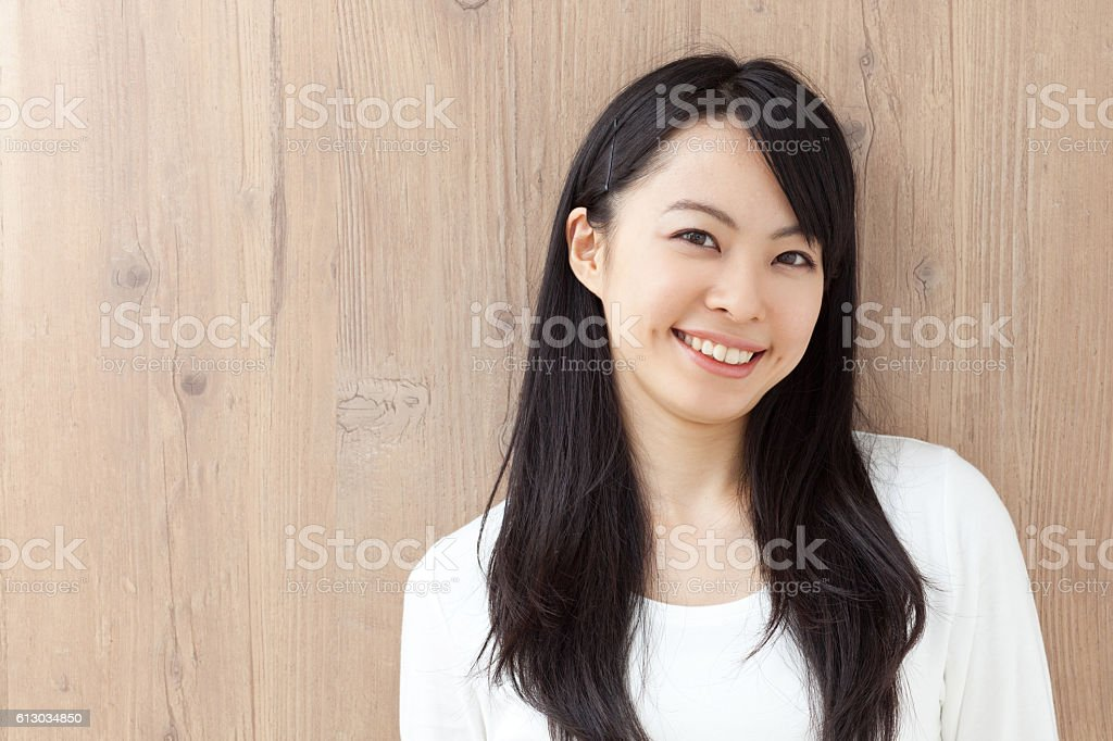 Japanese woman in front of grained wall stock photo