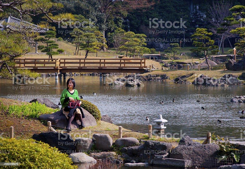 Japanese Woman in Hamarikyu Garden, Tokyo stock photo