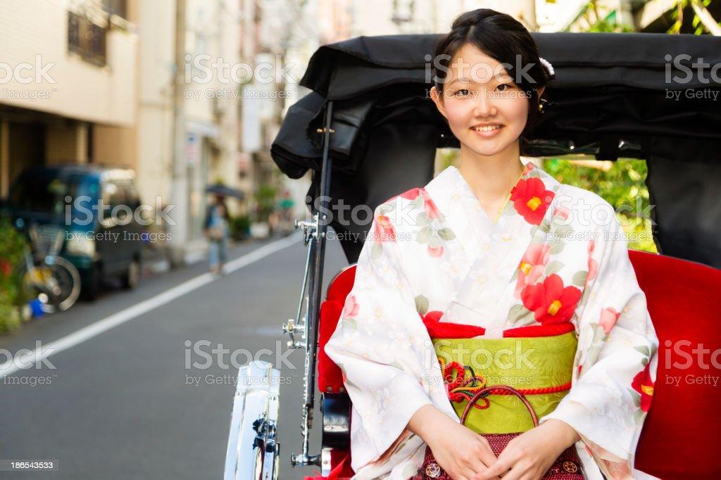 Japanese Woman in Jinrikisha royalty-free stock photo