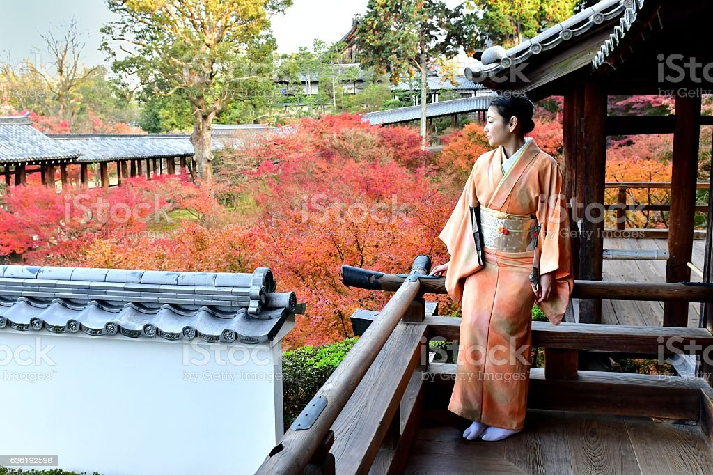 Japanese Woman in Kimono Enjoying Autumn Foliage at Tofuku-ji, Kyoto stock photo