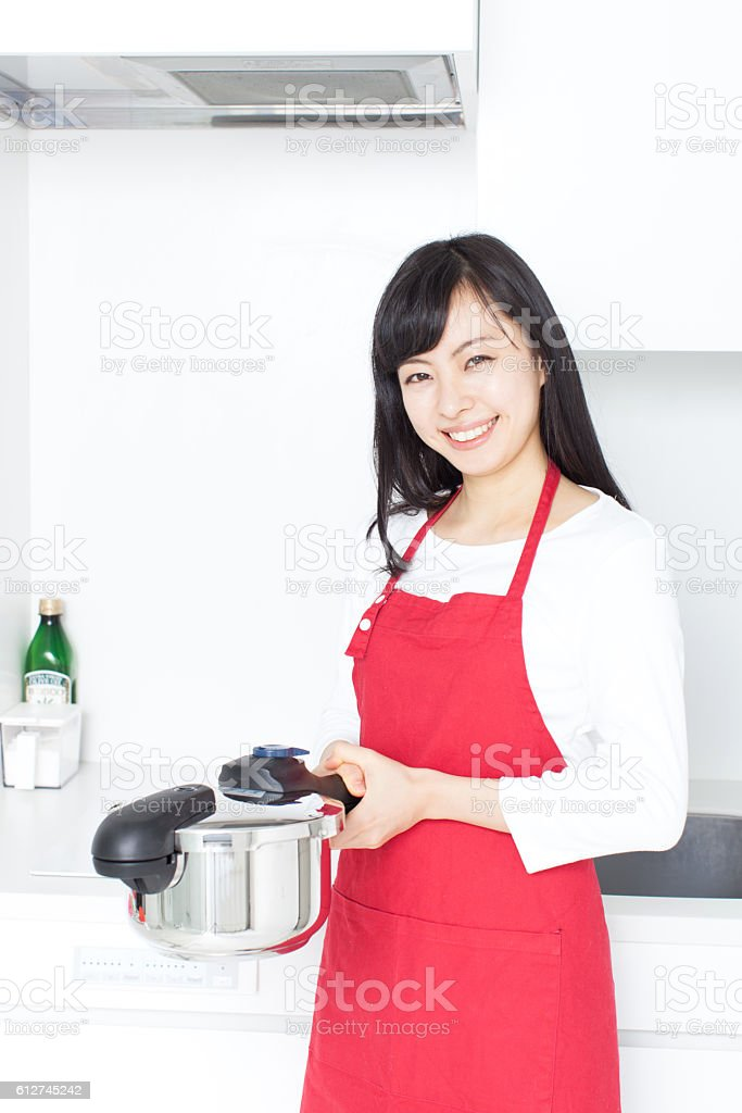 Japanese woman in the kitchen stock photo