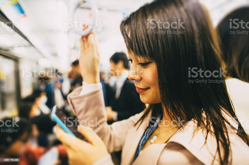 Japanese woman in the metro stock photo