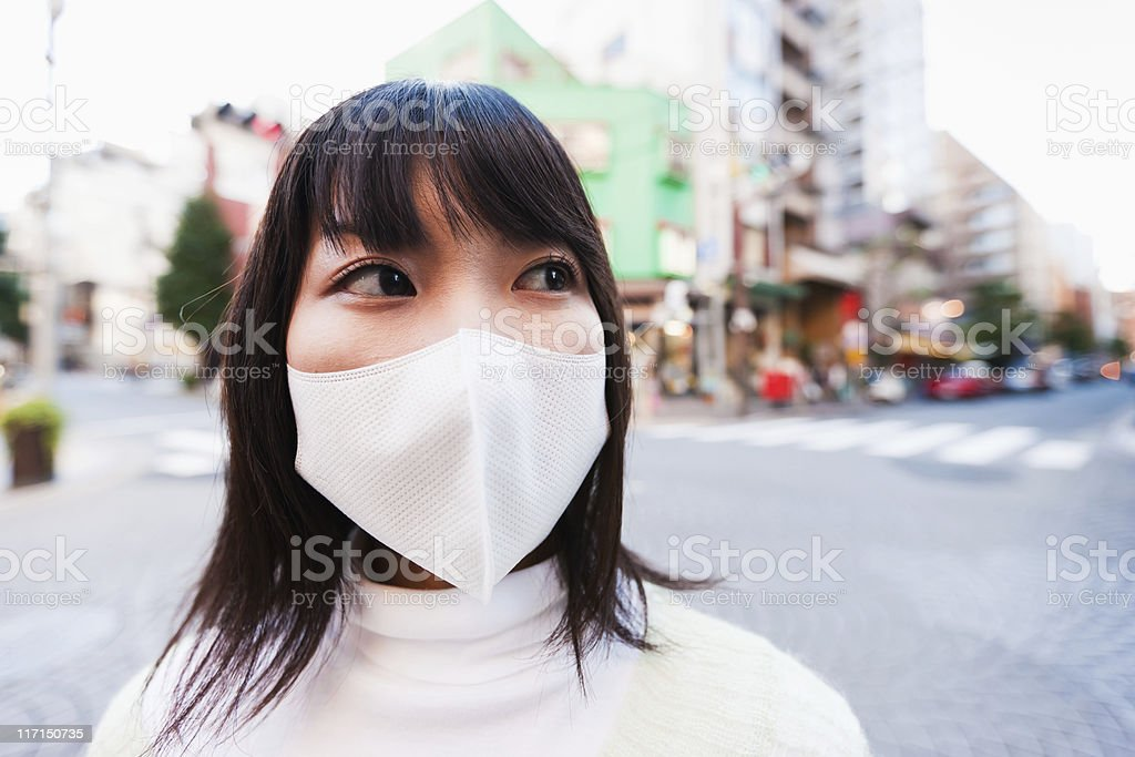 Japanese Woman in Tokyo with Facial Protection Mask royalty-free stock photo
