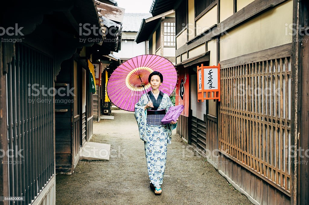 Japanese Woman In Traditional Clothes Walking in Kyoto stock photo