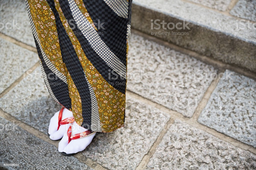 Japanese woman in traditional sandals stock photo
