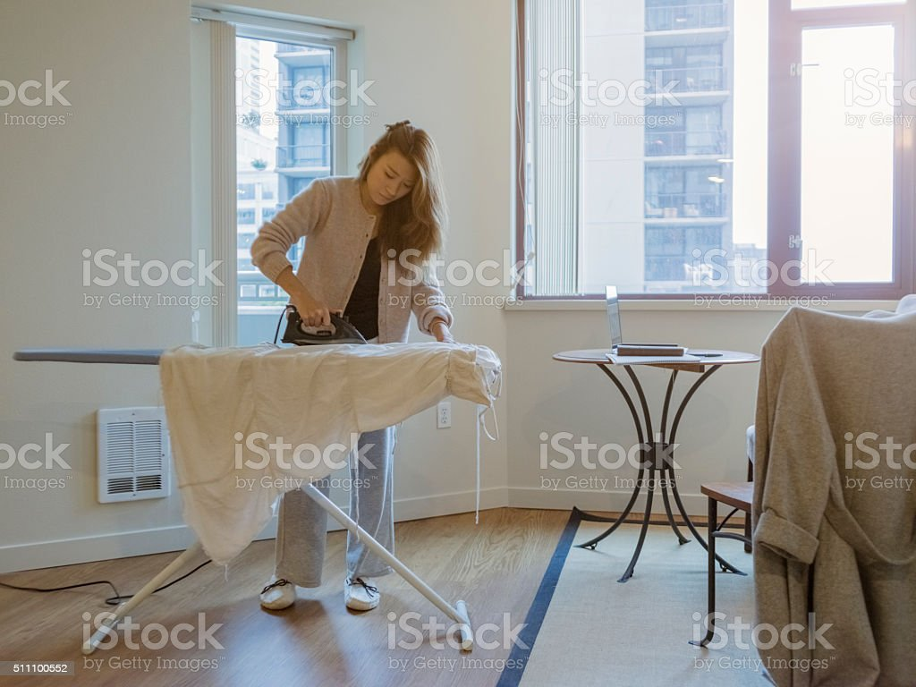 japanese Woman Ironing Clothes stock photo