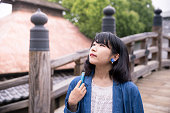 Japanese woman looking at the sky