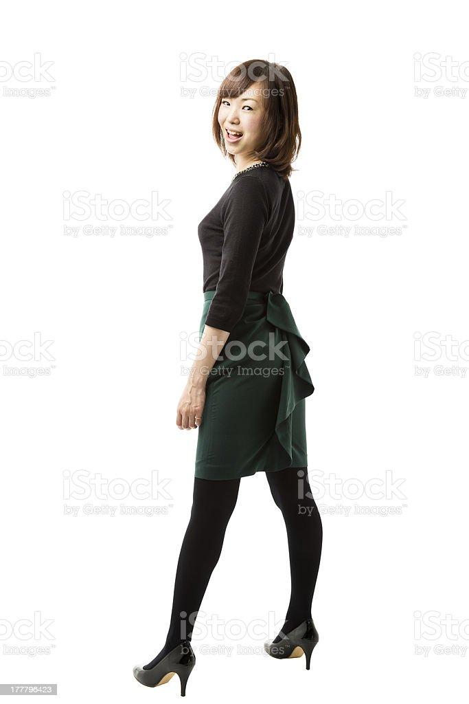 Japanese Woman Looking Back at Camera royalty-free stock photo