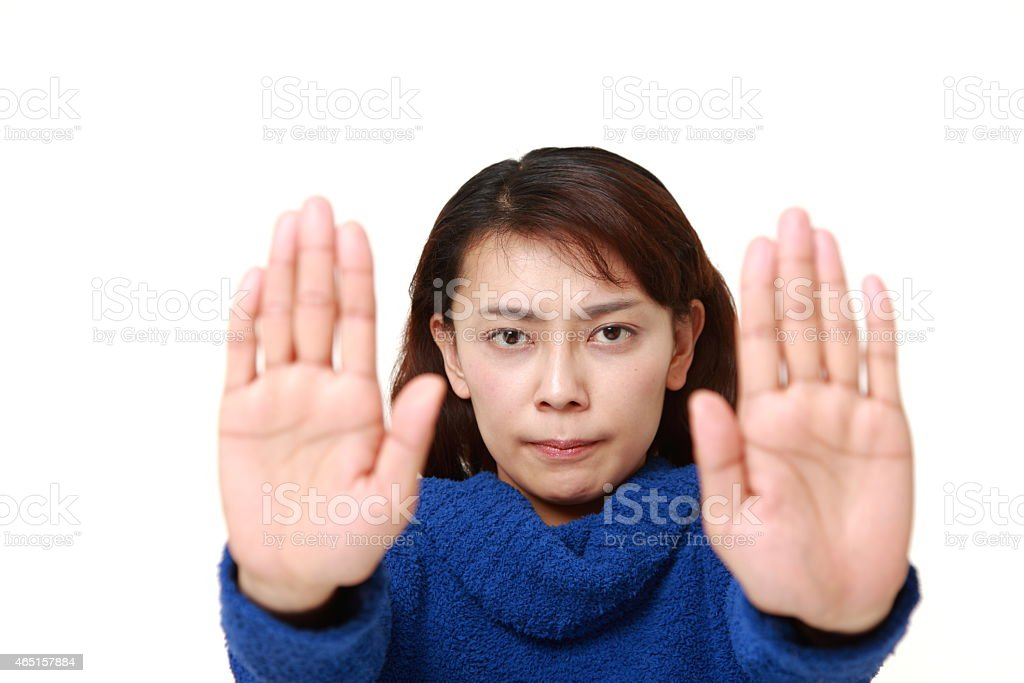 Japanese woman making stop gesture stock photo