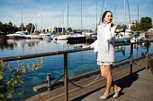 Japanese woman near yacht on blue sky background, selective focus