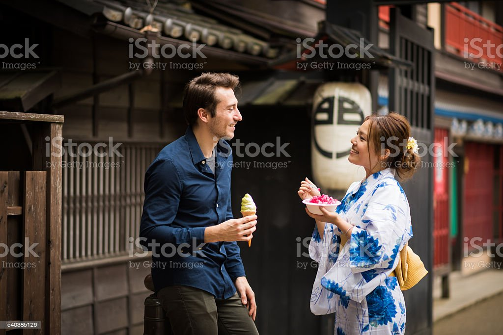 Japanese woman on a date with a caucasian male stock photo