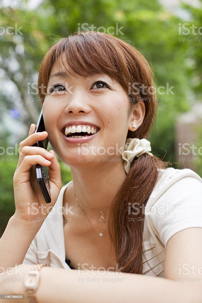 Japanese woman on a mobile phone royalty-free stock photo