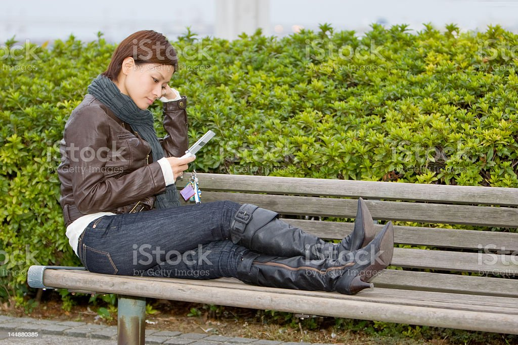 Japanese woman on a park bench royalty-free stock photo