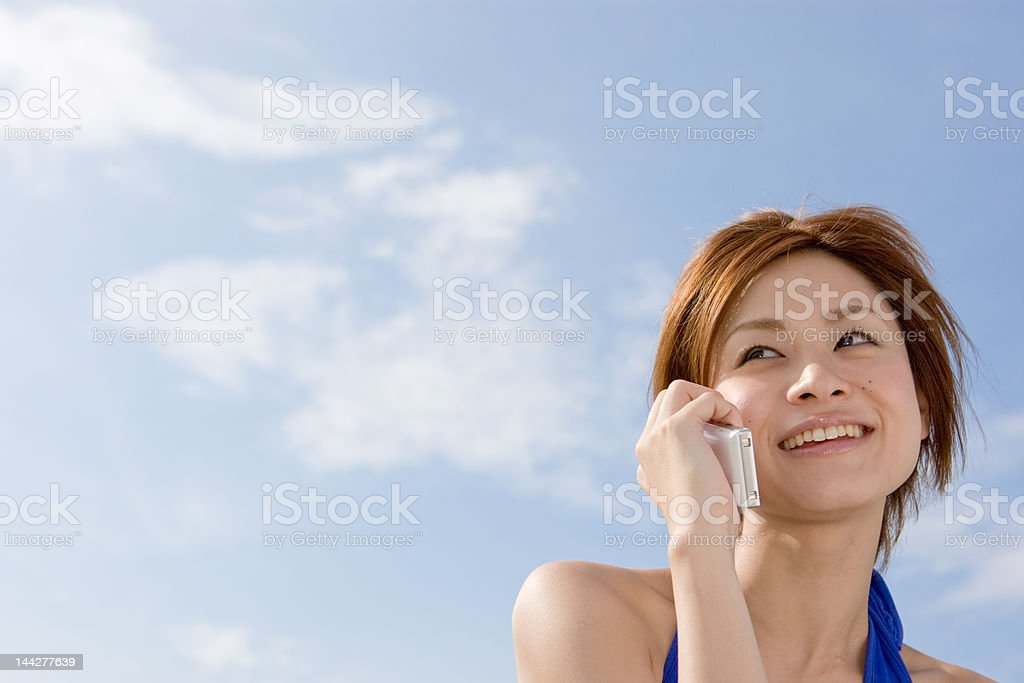 Japanese woman on the phone royalty-free stock photo