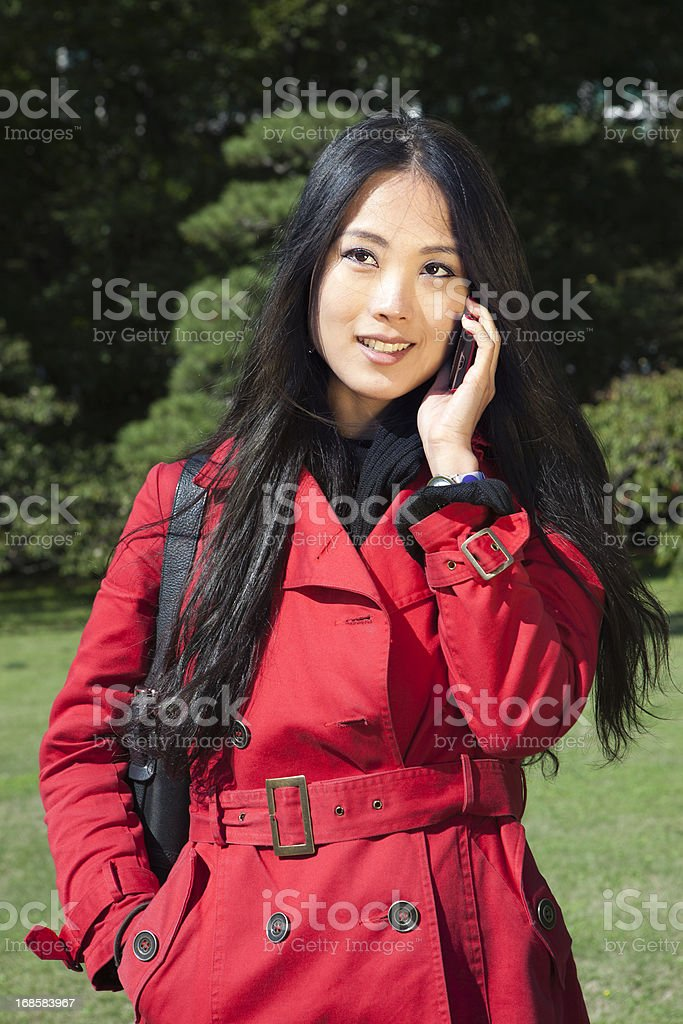 Japanese Woman On The Phone, Tokyo, Japan stock photo