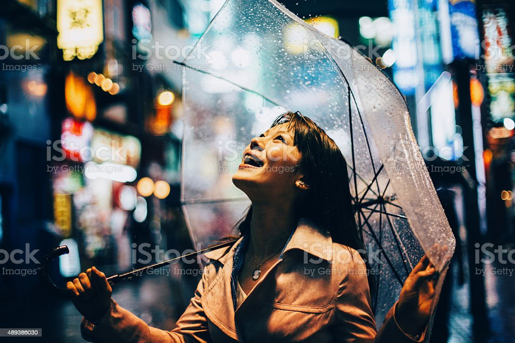 Japanese woman outside in the rain stock photo