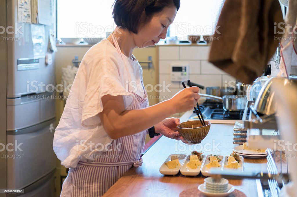 Japanese Woman Preparing Dinner in Home Kitchen, Kyoto, Japan stock photo