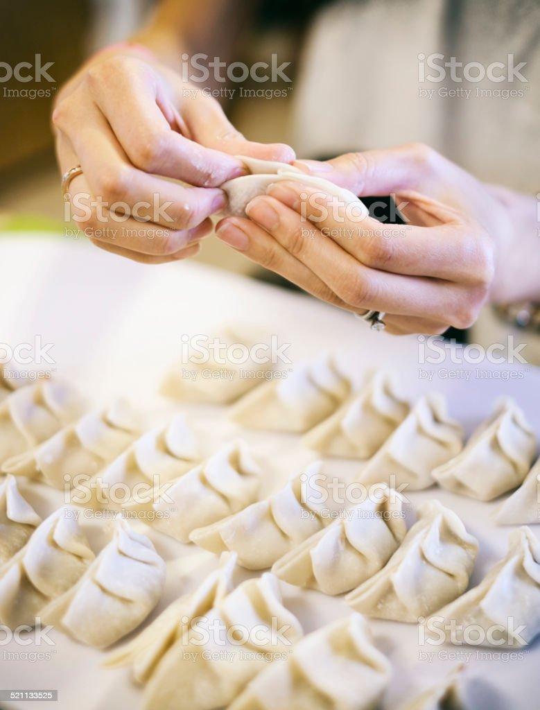 Japanese Woman Preparing Gyoza stock photo