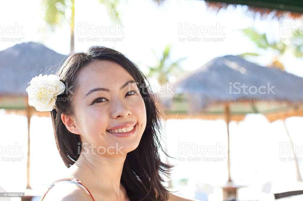 Japanese woman smiling on the beach stock photo