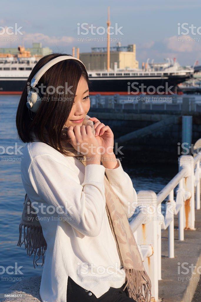 Japanese woman standing on harbor stock photo