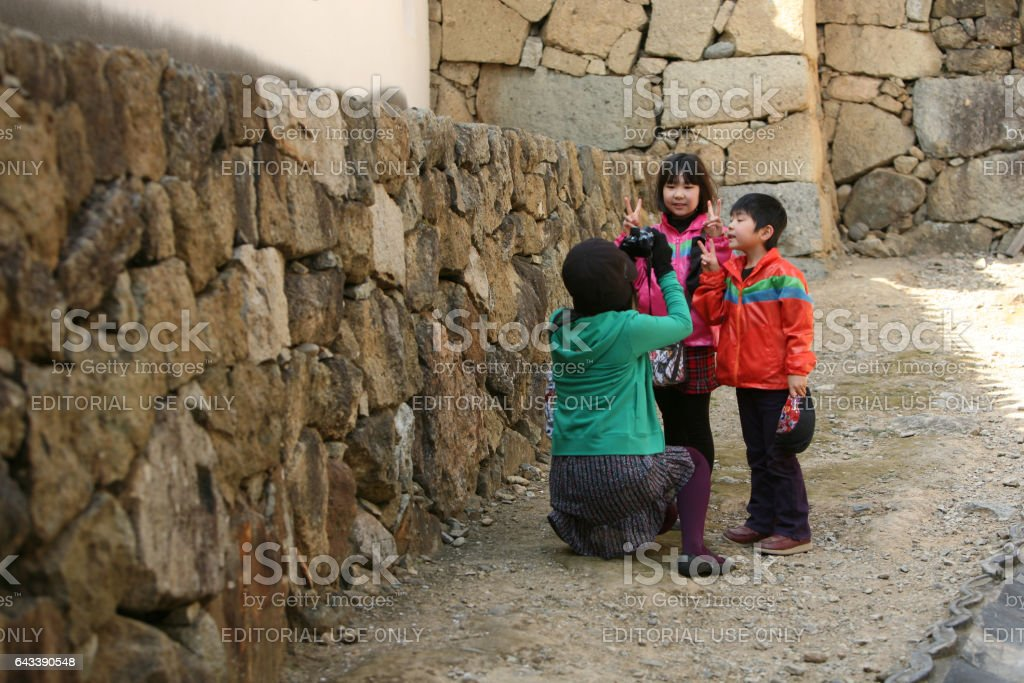 Japanese woman taking pictures of children stock photo