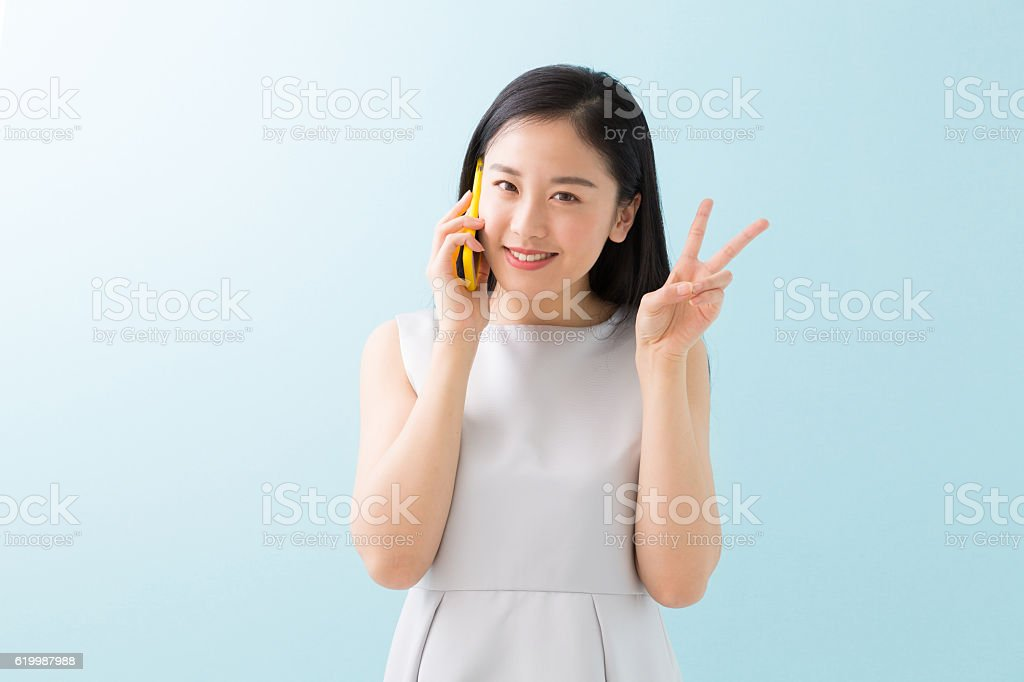 Japanese woman talking on a smart phone stock photo