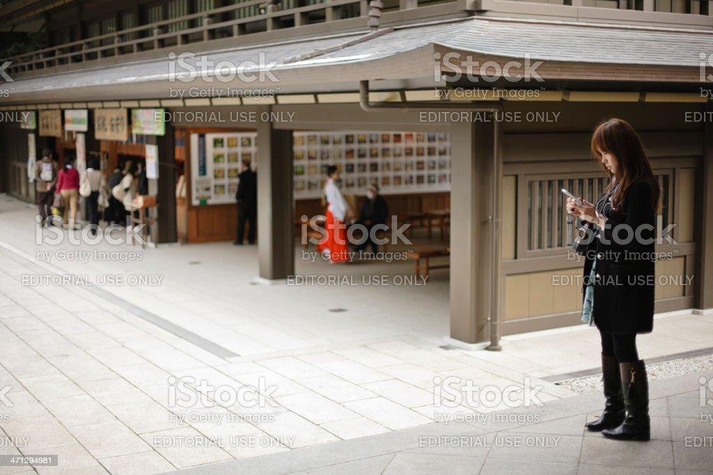 Japanese Woman Texting at Meiji Shrine royalty-free stock photo