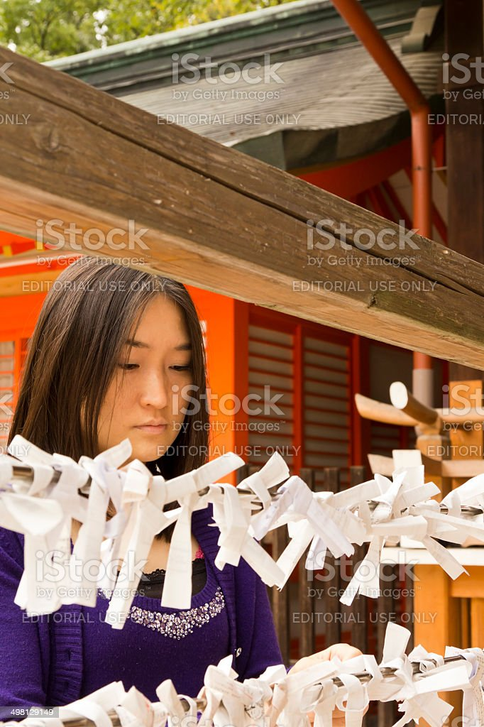 Japanese Woman Tying Her Fortune stock photo