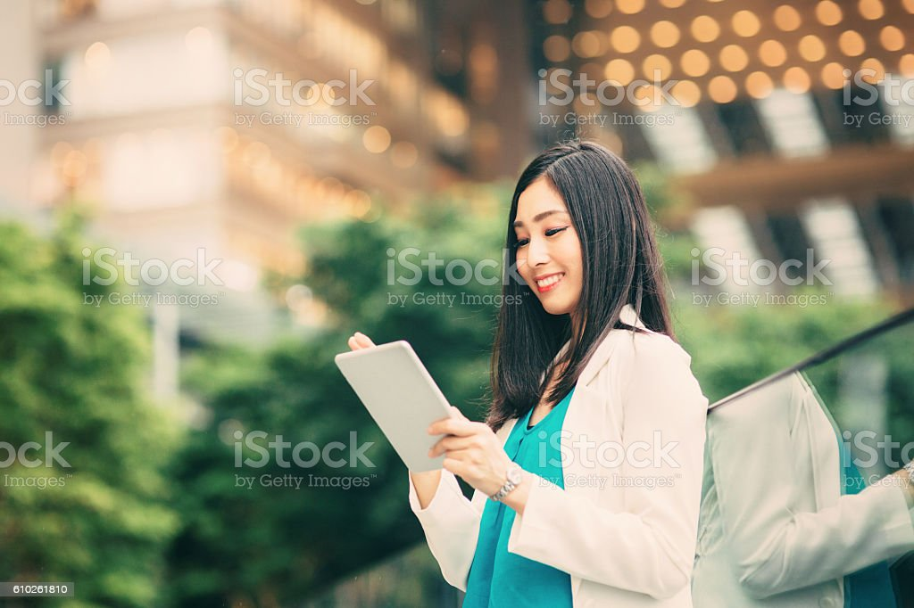 Japanese woman using a tablet stock photo