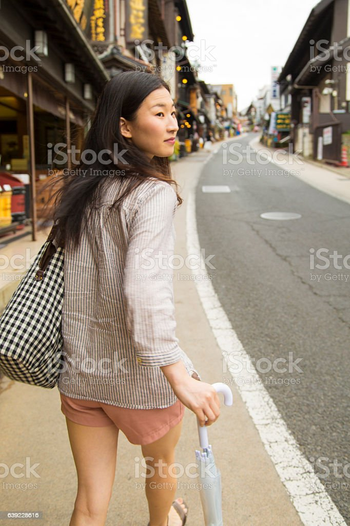 Japanese woman walking in Narita, Japan stock photo