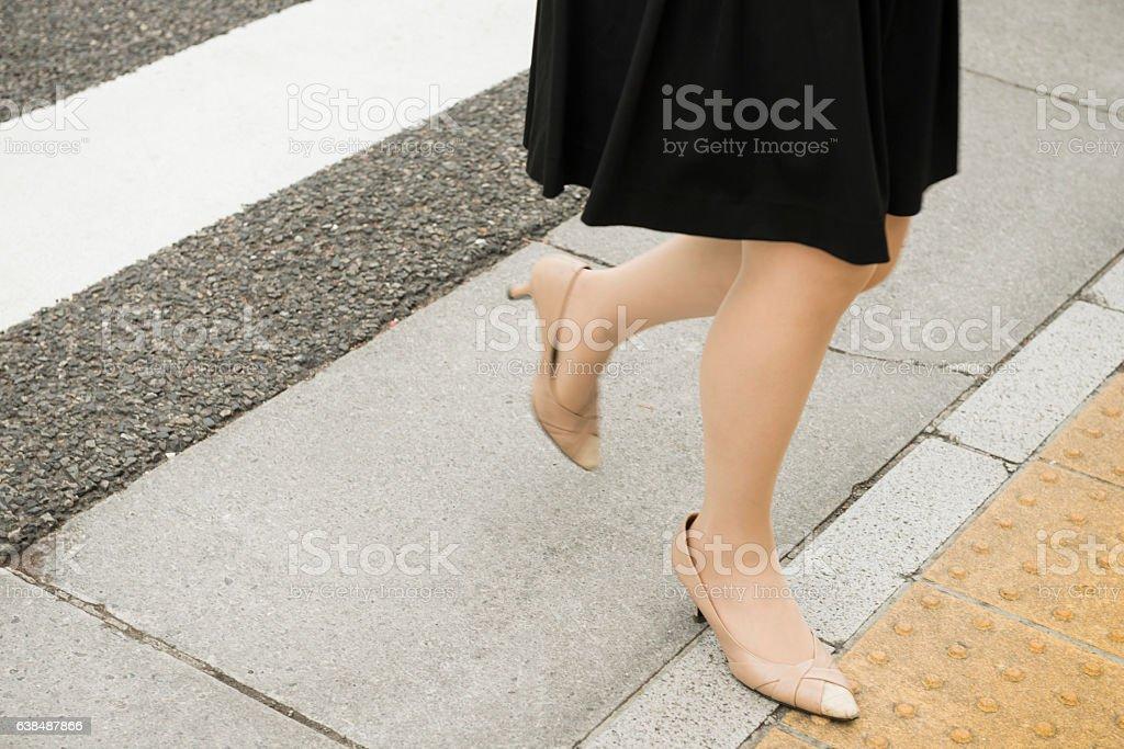 Japanese Woman Wearing Heels Walks Across Street Crosswalk Nagoya Japan stock photo