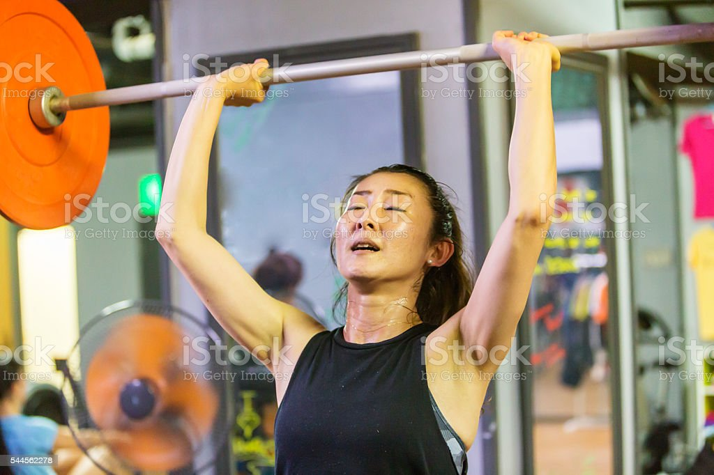 Japanese woman Weightlifting During a Cross Training Workout stock photo